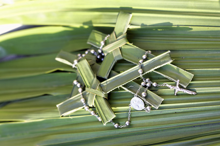 palm sunday: palm crosses with rosary beads