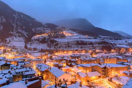Snowy sunrise in the town of Canillo, Andorra. Cityscape  in Winter.