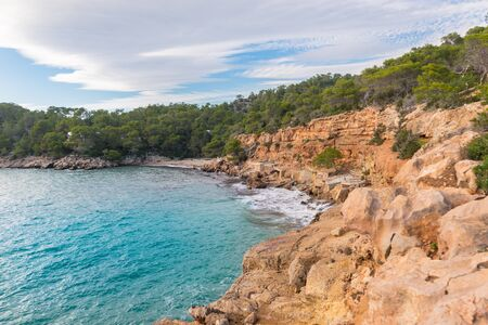 Cala Salada and Saladeta in san Antonio Abad at Balearic Islands Spain. Typical house for fishing boats and rocks.