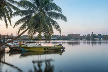 Sunshine over Bentota river, Galle district, Sri Lanka on a perfectly still day under a cloudless sky. Bentota, Sri Lanka.