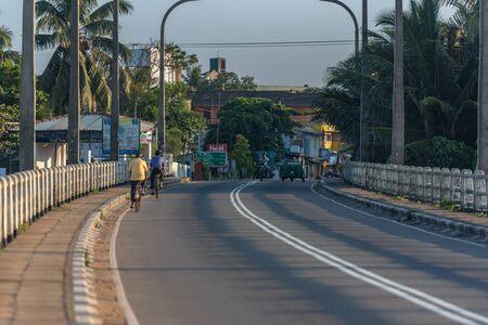 Aluthgama Main Street sunshine over Bentota river, Galle district, Sri Lanka on a perfectly still day under a cloudless sky. Bentota, Sri Lanka.