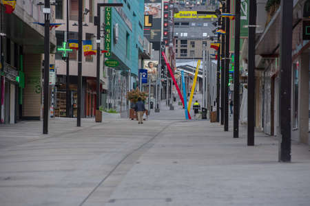 Andorra La Vella : 2020 April 11 : Streets without people in the pedestrian town of Meritxell in Andorra city center La vella, the capital of Andorra, all closed due to confinement by the COVID-19 virus. Редакционное