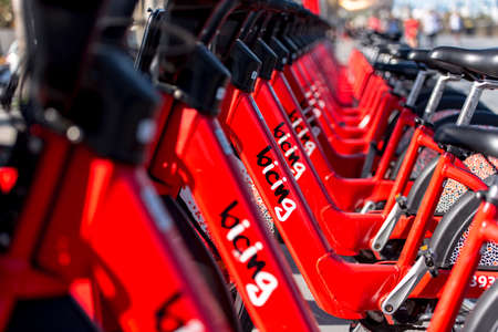 Barcelona, Spain - June 26, 2020: Bright red bicycles available for rent parked in a row at La Barceloneta. Concept of environmentally sustainable transport. Bike rental service Bicing. 報道画像