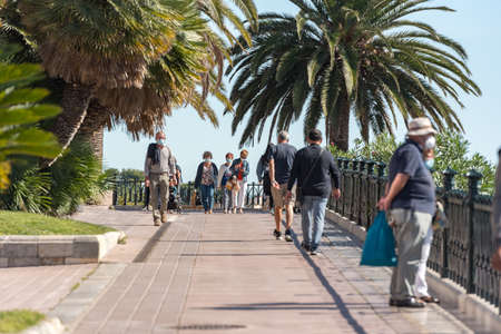 Tarragona, Spain: 2020 September 27: Sunny day in Tarragona, People in Passeig de les Palmeres in Spain