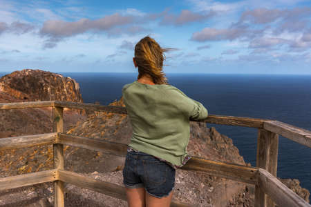 Blonde woman in the View Point in La Entallada lighthouse on the island of Fuerteventura, Spain.