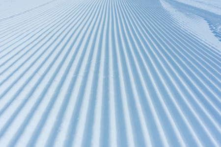 Skiing background - fresh snow on ski slope.