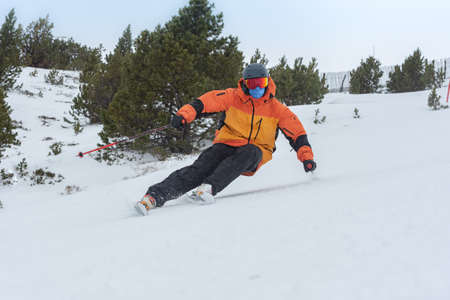 Young man skiing in the Pyrenees at the Grandvalira ski resort in Andorra in Covid19 time.