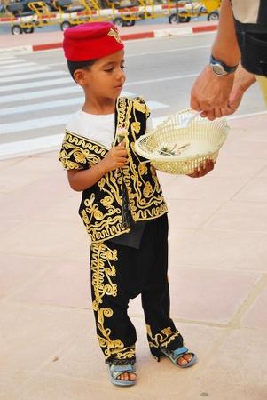 Arabic child selling flowers