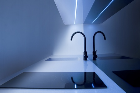Water tap in the modern kitchen with blue light Stock Photo