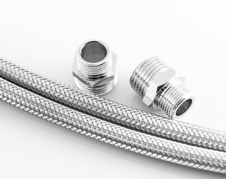 close fitting: industrial elastic metal fiber water pipe with connectors Stock Photo