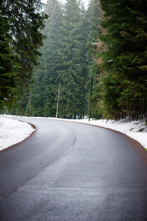 road ahead: the road ahead. countryside in winter, trees and shadows Stock Photo