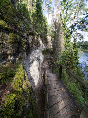 ancient sandstone cliffs with inscriptions in the Gaujas National Park, Latvia