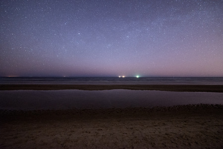 meteors: night sky with stars on the summer beach. space view from earth Stock Photo