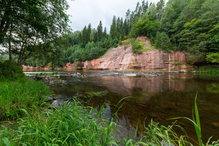 latvia: sandstone cliffs on the river shore in the Gaujas National Park, Latvia