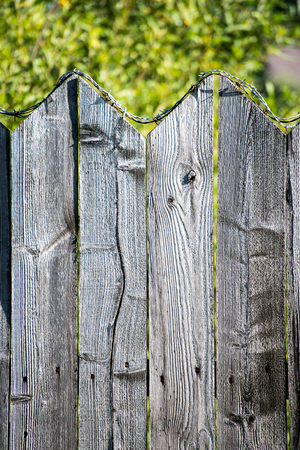 old wooden fence with barbed wire on top Stock Photo