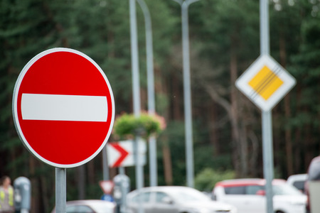 road signs and lines on asphalt