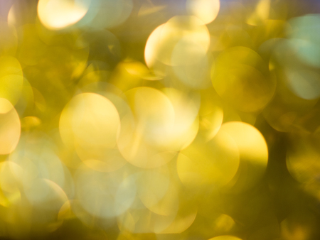 Abstract Festive background. Christmas and New Year feast bokeh background with copyspace. Holiday party background with blurry boke special magic effect. Stock Photo