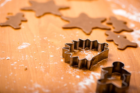 pastry cutters: Making Gingerbread Cookies Series. Preparing and cutting dough sheet into shapes. Stock Photo