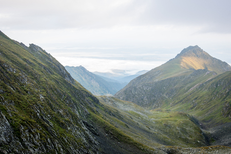 Misty rocky view in Fagaraš mountains in Southern Carpathians, Romania Stock Photo
