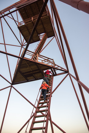 people climbing the watch tower