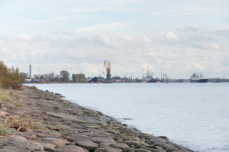 cargo dock and cargo ships in seaport in Riga. latvia Editorial