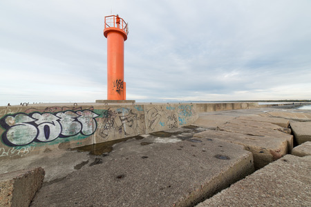 breakwater in the sea with lighthouse on it near Riga, latvia