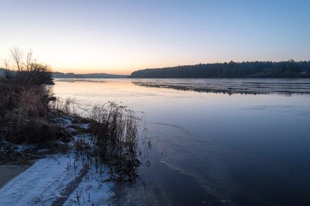 Beautiful winter landscape with frozen lake. Stock Photo
