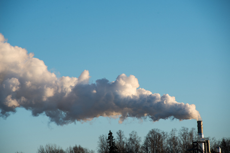 industrial park: industrial park with chimney and white smoke on blue sky Stock Photo