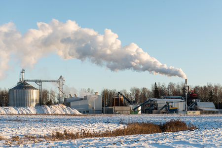 industrial park: industrial park with chimney and white smoke on blue sky Editorial