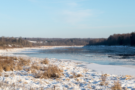 frozen river: beautiful snowy winter landscape with frozen river and blue sky Stock Photo