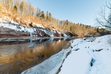 hoarfrost: frozen river in winter with sandstone cliffs and ice blocks. Gauja National Park. Latvia.