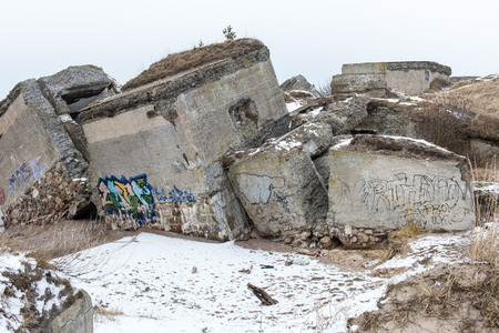 old war fort ruins on the beach in winter. Liepaja, Latvia Stock Photo