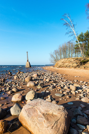 old ruins of lighthouse on the shore of Baltic beach Stock Photo