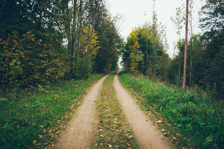 empty country road with perspective Retro grainy color film look.