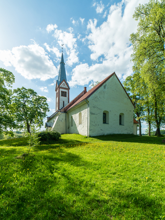 countryside church building in summer in small village