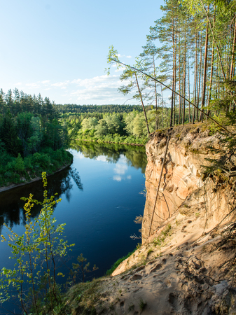 teutonic: sandstone cliffs by the river in Gauja national park in latvia Stock Photo