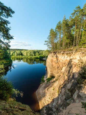sandstone cliffs by the river in Gauja national park in latvia Banco de Imagens