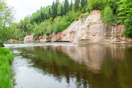 sandstone cliffs by the river in Gauja national park in latvia Stock Photo