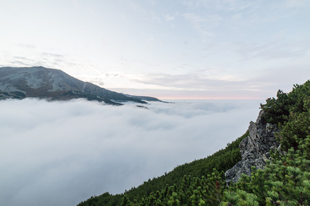 tatra: Tatra mountains in Slovakia covered with clouds. autumn colors. Stock Photo