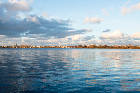 White clouds over the river with blue sky and city skyline Stock Photo