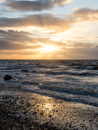 currents: Storm large wave on the shore of the Baltic sea beach Stock Photo