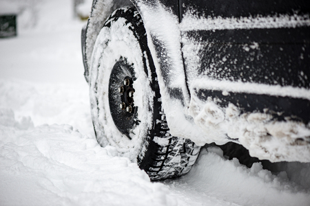 winter tires: offroad car tires stuck in the snow in cold winter Stock Photo