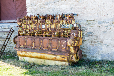 an old outdated diesel engine with gauges Editorial