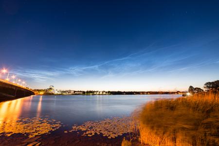 atmospheric phenomena: Beautiful sky phenomenon noctilucent clouds over beach in Latvia