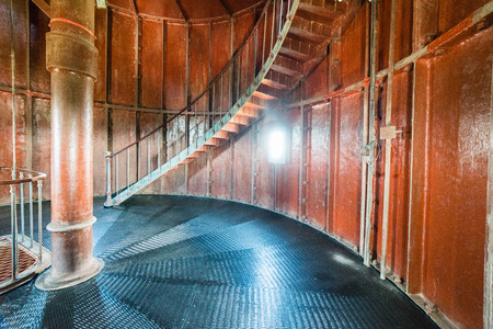 A spiral staircase inside a old wooden lighthouse. Stock Photo