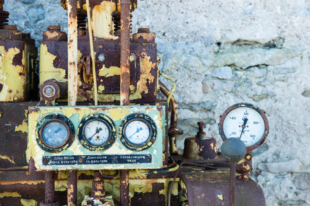 an old outdated diesel engine with gauges Stock Photo