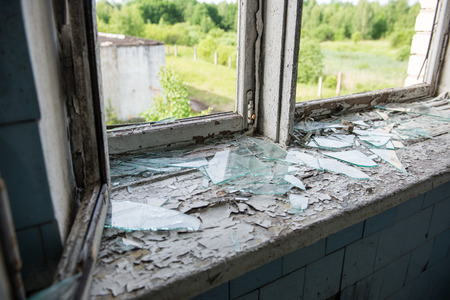 infirmary: broken windows with smashed glass and dust Stock Photo
