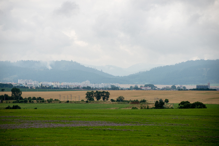 plowing: Cultivated field in bright spring day in countryside