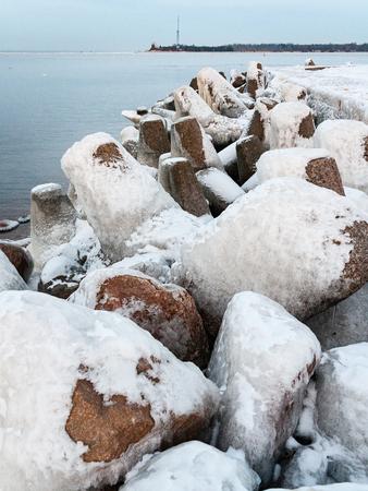 frozen countryside scene in winter with snow. beach scene with ice blocks Stock Photo