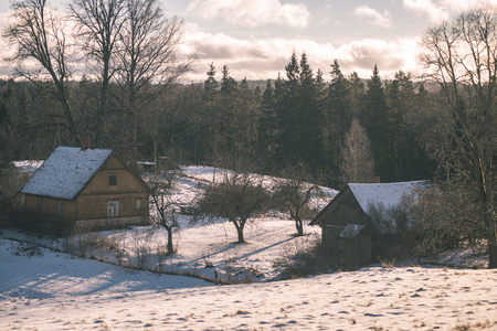 frozen countryside scene in winter with snow. cottage with shed